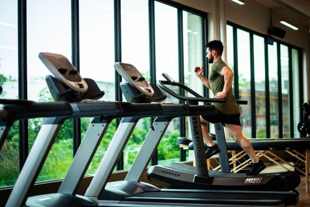 Runner on treadmill at empty gym